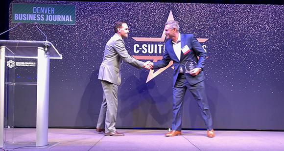 Bill Baldwin accepting the c-suite award