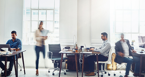 Coworking space, open office, blurred woman
