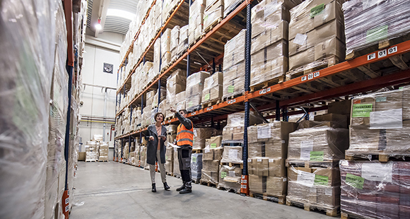 Two people looking at warehouse racking