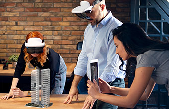 Three people looking at 3d object by using tablet and AR glasses.