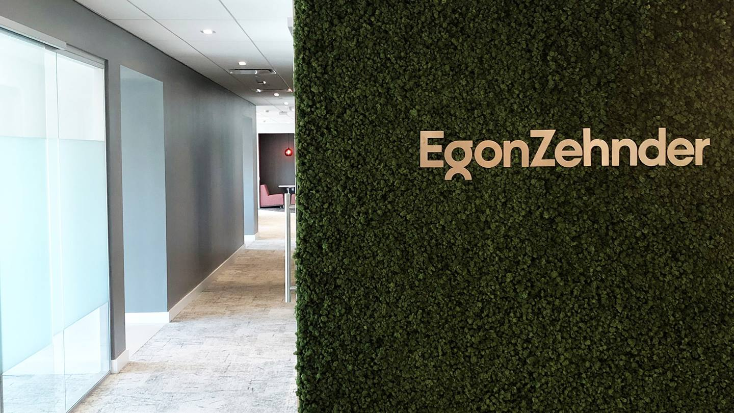Egon Zehnder logo on green leaf wall